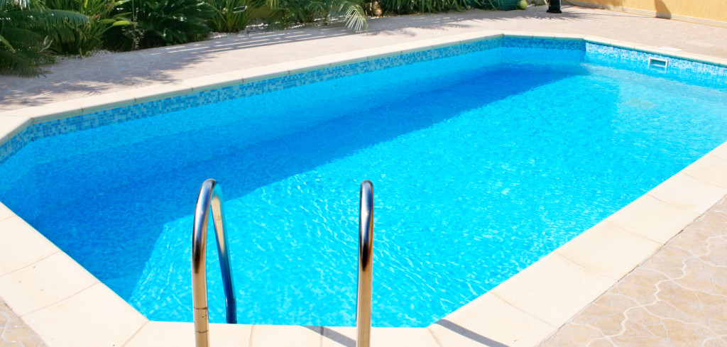 Swimming pool blue transparent water.
