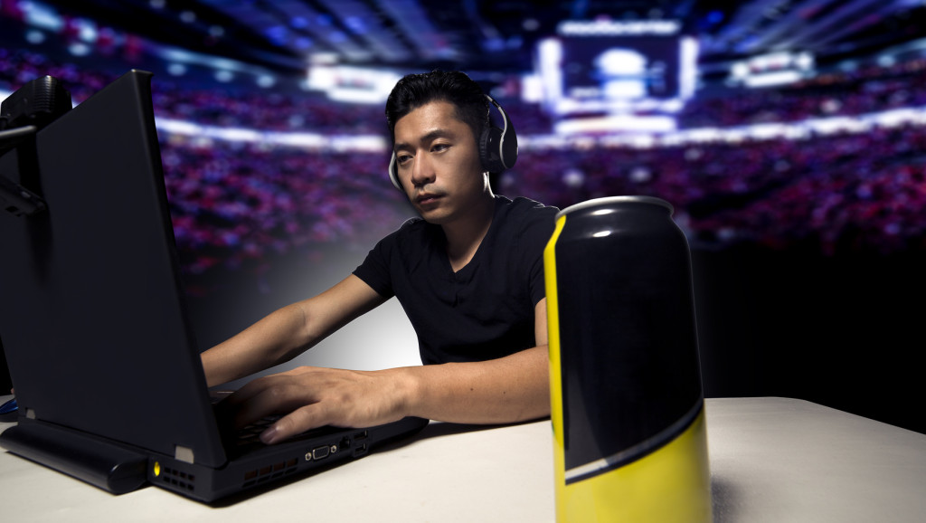 Competitive eSport video game  player drinking a canned energy drink as a stimulant.  These beverage often contain caffeine and guarana.